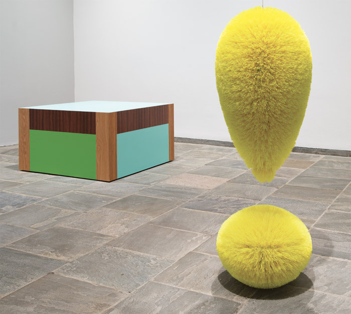 "View of ""Richard Artschwager!,"" 2012–13. Background: Table (Somewhat), 2007. Foreground: Exclamation Point (Chartreuse), 2008. Photo: Bill Orcutt."