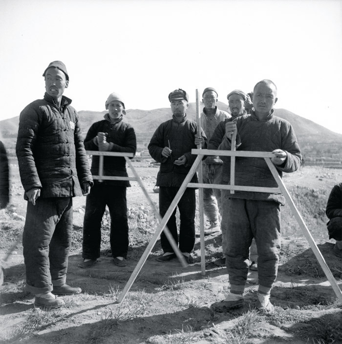 "David Crook, Measuring the Land (in Ten Mile Inn in Jinjiluyu Liberated Area, China), 1948, ink-jet print, 20 x 20"". From ""Rural North China, 1947–1948."""