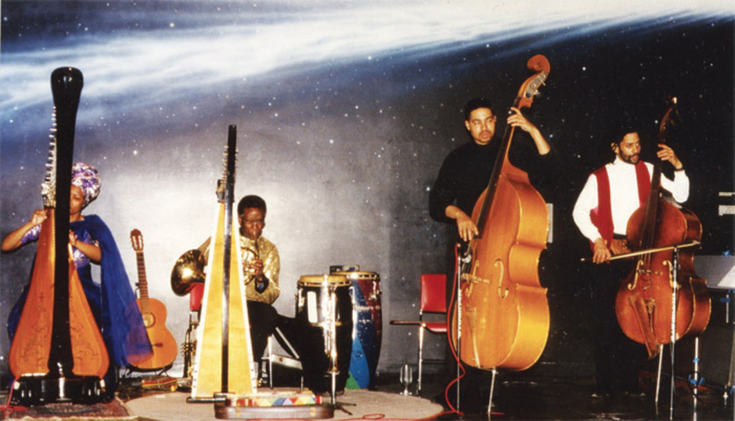 Kelan Phil Cohran and Legacy performing at the Adler Planetarium, Chicago, 1993. From left: Aquilla Sadalla, Kelan Phil Cohran, Malik Cohran, and Oscar Brown III.