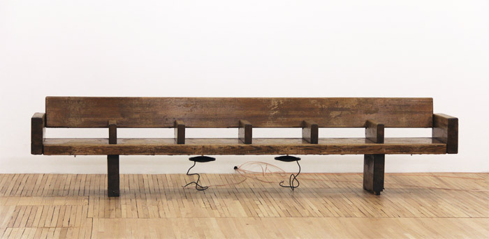 "Sergei Tcherepnin, Motor-Matter Bench, 2013, wood subway bench, transducers, amplifier, HD media player, 2' 4 1/2"" x 10' 6 1/2"" x 1' 8 1/2""."