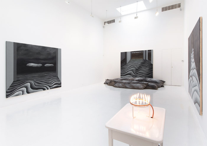 "View of ""Mary Beth Edelson,"" 2013. Foreground: Fire Altar, 1973. Background, from left: Passage  Series: Two Clouds, 1972–73; Passage Series: Dawning, 1972–73; Passage Series: Night Passage, 1972–73."