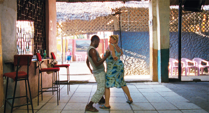 Ulrich Seidl, Paradise: Love, 2012, 35 mm, color, sound, 120 minutes. Beach Boy (Gabriel Nguma Mwarua) and Teresa (Margarethe Tiesel).
