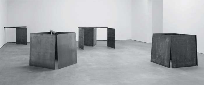 "View of ""Richard Serra,"" 2013. From left: Equal (Corner Prop Piece), 1969–70; 5:30, 1969; V+5: To Michael Heizer, 1969; One Ton Prop (House of Cards), 1969."