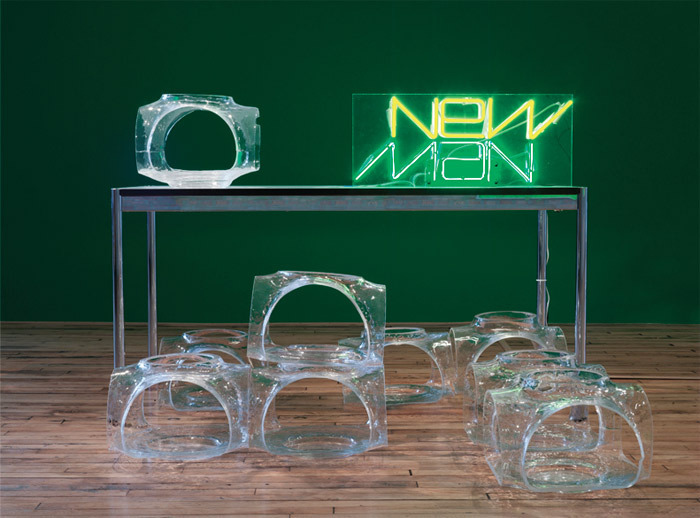 "David Hartt, Mutirão III, 2013, USM Haller table, nine hand-blown glass sculptures, magazine, neon sign, 41 1/4 x 70 x 59""."