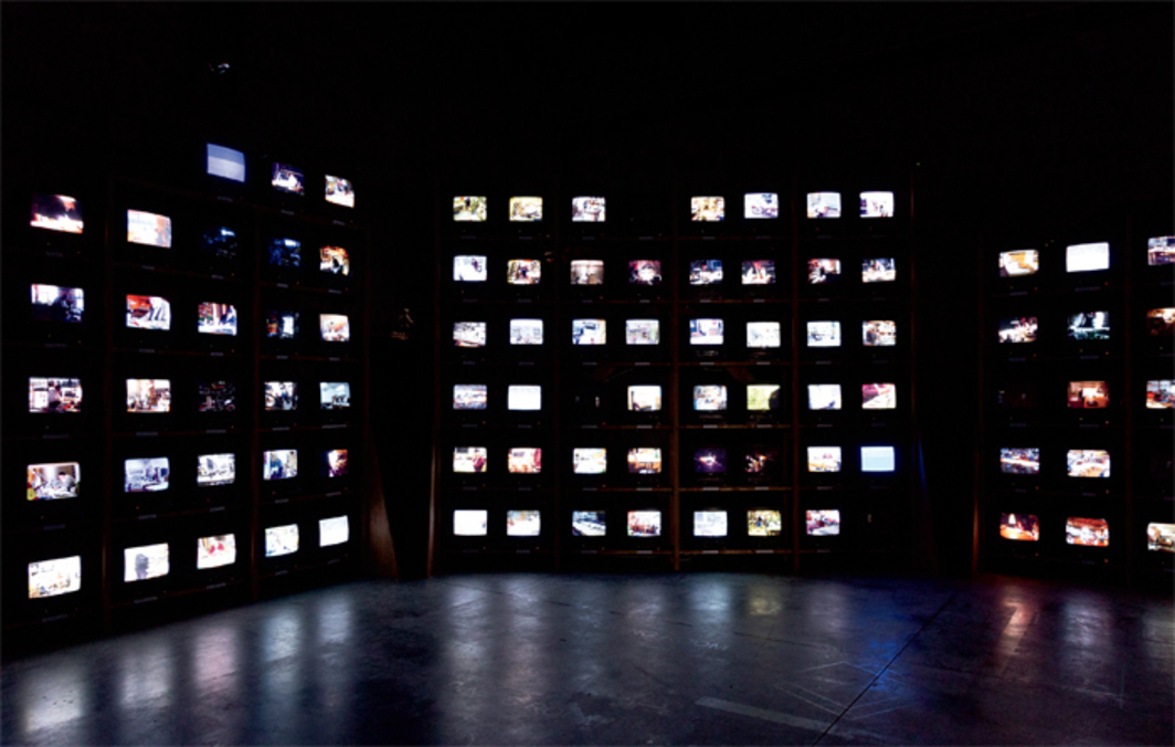 "Dieter Roth, Solo Szenen (Solo Scenes), 1997–98, 131 video monitors, media players, shelving. Installation view, Arsenale, Venice, 2013. From ""The Encyclopedic Palace."" Photo: Kate Lacey. © Dieter Roth Estate."