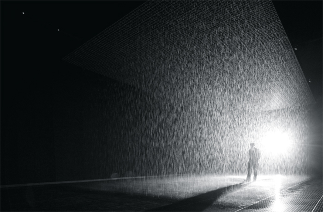 Random International, Rain Room, 2012, water, injection-molded tiles, solenoid valves, pressure regulators, custom software, 3-D tracking cameras, steel beams, water-management system, grated floor. Installation view, Museum of Modern Art, New York, 2013.