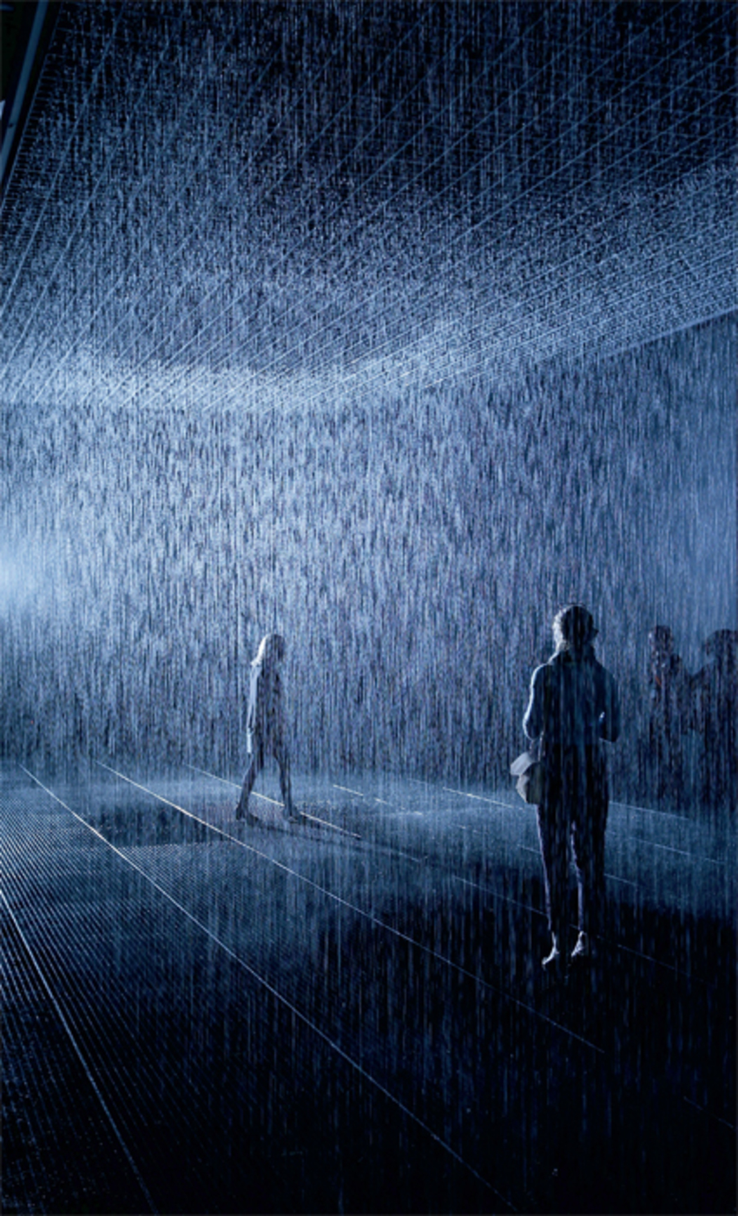 Random International, Rain Room, 2012, water, injection-molded tiles, solenoid valves, pressure regulators, custom soft- ware, 3-D tracking cameras, steel beams, water-management system, grated floor. Installation view, Barbican Centre, London. Photo: Photo: Oli Scarff/Getty Images.