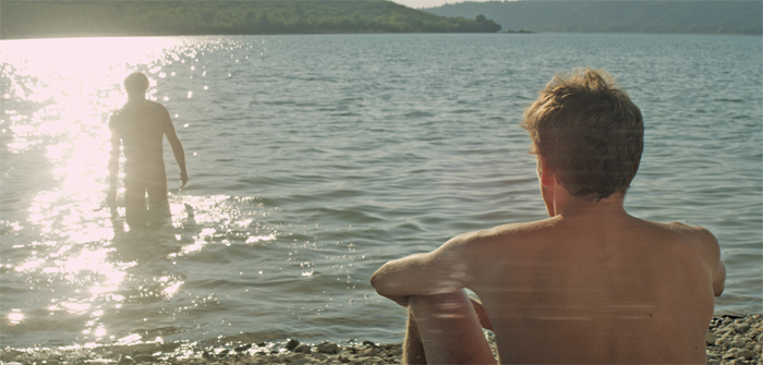 Alain Guiraudie, L'Inconnu du lac (Stranger by the Lake), 2013, 35 mm, color, sound, 97 minutes. Michel (Christophe Paou) and Franck (Pierre Deladonchamps).
