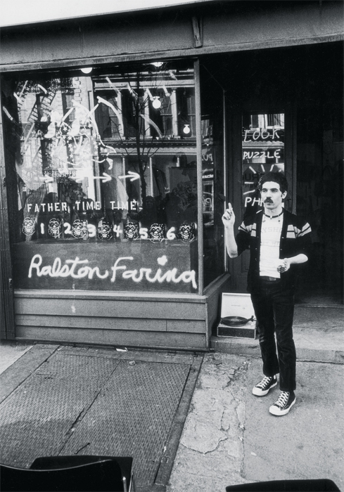 Ralston Farina in front of the shopwindow display for his performance Look Puzzle Phase 3, 1973, 126 Prince Street, New York, March 23, 1973. Photo: Fred W. McDarrah/Getty Images. Dennis Hermanson/ Ralston Farina Archives.