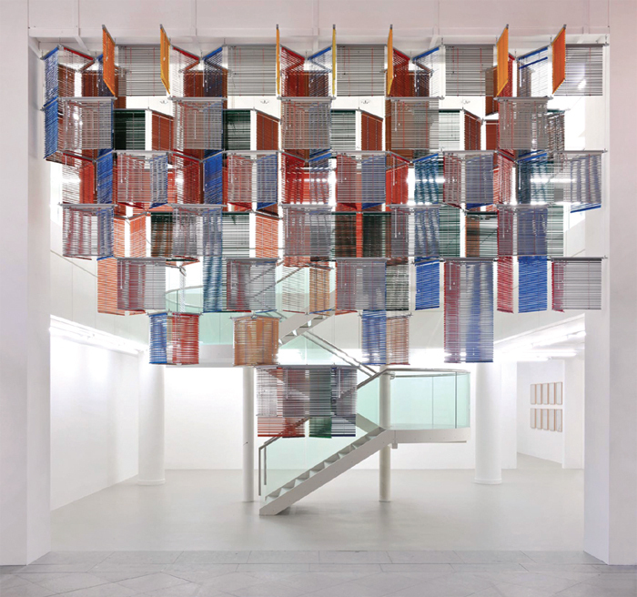 Haegue Yang, Blind Curtain—Flesh Behind Tricolore, 2013, aluminum venetian blinds and frame, 15 x 23 x 5'.