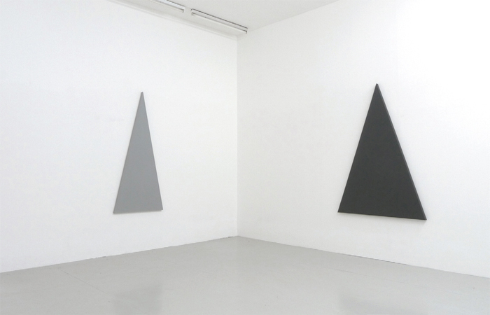 "View of ""Alan Charlton,"" 2013. From left: Vertical Triangle Painting, 2013; Vertical Triangle Painting, 2013."
