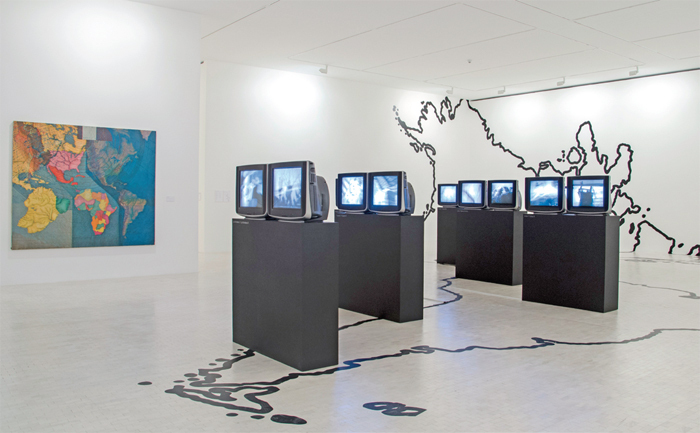 "View of ""Juan Downey,"" 2013. From left: World Map, 1979; Video Trans Americas, 1973–76."