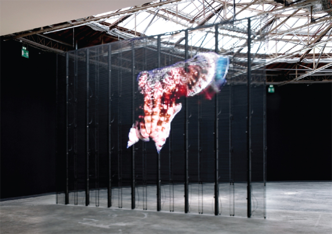 "View of ""Philippe Parreno: Anywhere, Anywhere, Out of the World,"" 2013, Palais de Tokyo, Paris. Center: TV Channel, 2013. On-screen: Alien Seasons, 2002. Photo: Aurélien Mole."