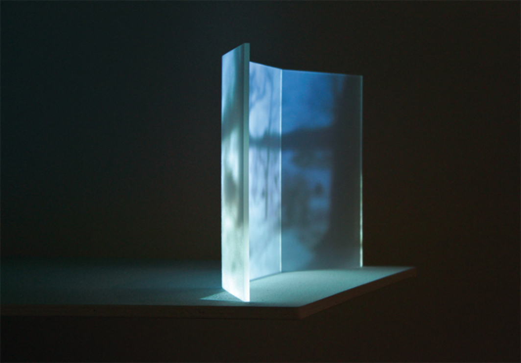 "Casilda Sánchez, Winter Landscape, 2013, HD-video projection, color, sound, 12 minutes 48 seconds; Plexiglas; acrylic paint, 19 x 10 x 3""."