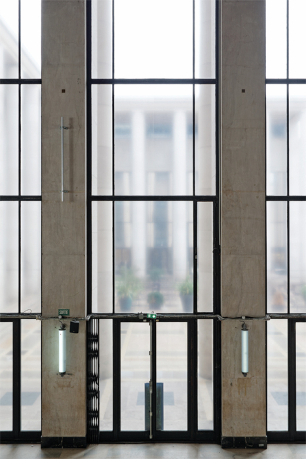 """View of Philippe Parreno: Anywhere, Anywhere, Out of the World,"" 2013. Sconces: 56 Flickering Lights (detail), 2013. Windows: Out of Focus Windows (detail), 2013."