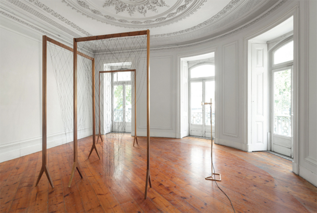 Leonor Antunes, the thread is so tiny that the eye, though armed with a magnifying glass, suspects it, rather than sees it II, 2013, agba wood, nylon thread, dimensions variable. Installation view.