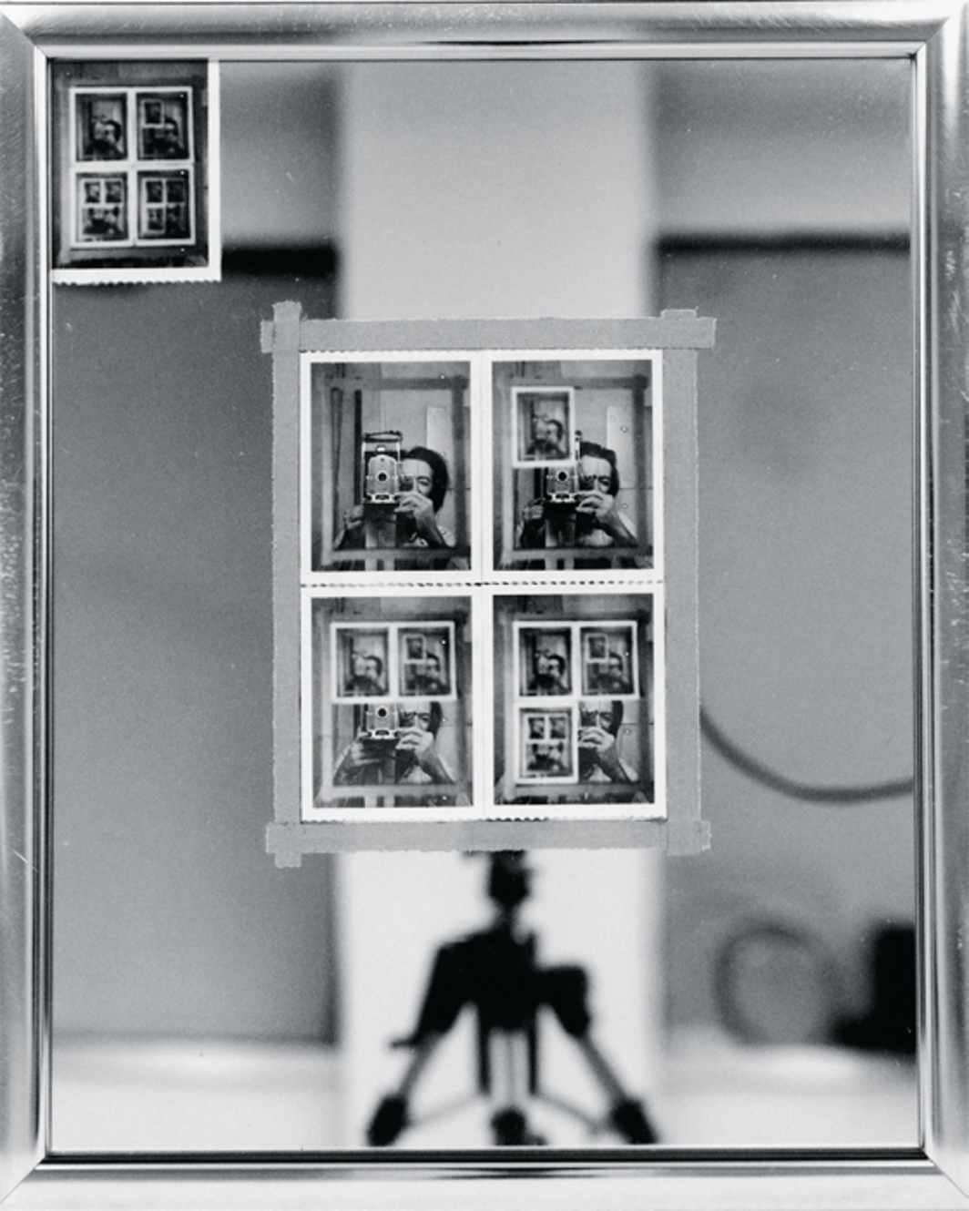 "Michael Snow, Authorization, 1969, Polaroid Type 55 prints, adhesive tape, mirror in metal frame, 21 1/2 x 17 1/2""."