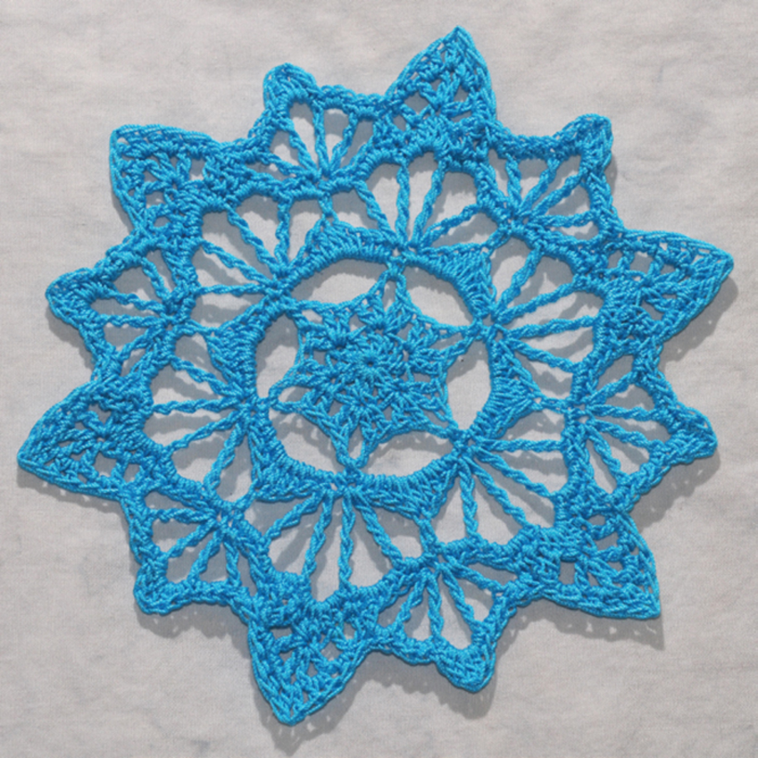 "*Deborah Atkinson, _Columbine Mine Snowflake_, 2011*, cotton thread, 5 1/2 x 5 1/2""."