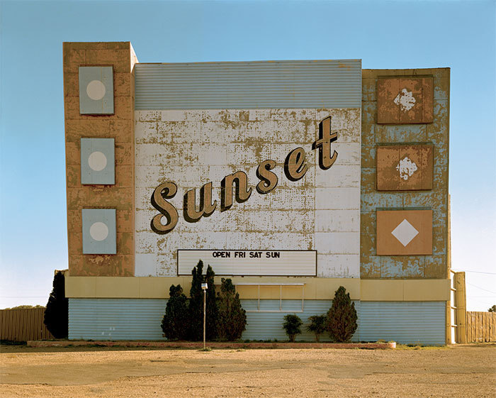 "Stephen Shore, West Ninth Avenue, Amarillo, Texas, October 2, 1974, color photograph, 20 x 24""."