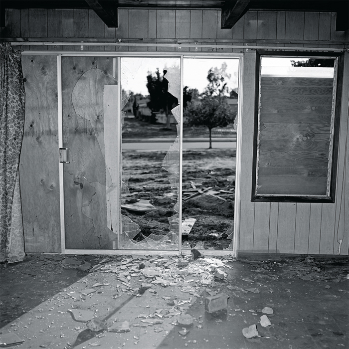 "John Divola, Forced Entry, Site 29, Interior View A, 1975, gelatin silver print, 20 x 16"". From the series ""LAX/Noise Abatement Zone,"" 1975–76."