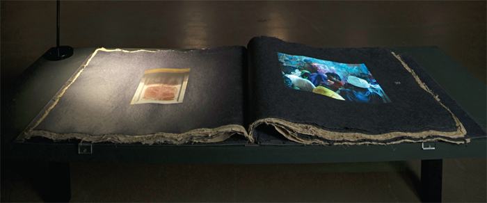 "Amar Kanwar, The Prediction, 1991–2012, silkscreened, handmade banana-fiber-paper book and digital projection (color, silent, 8 minutes); book: 22 3/4 x 55 1/2""."