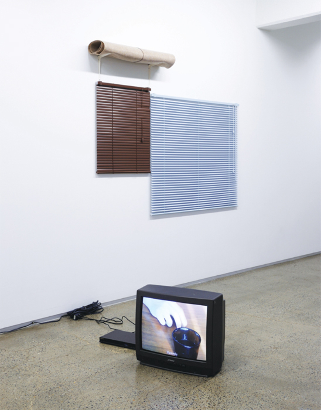 Lee Kit, What to do?, 2014, mixed media with video (color, silent, 5 minutes 24 seconds). Installation view.