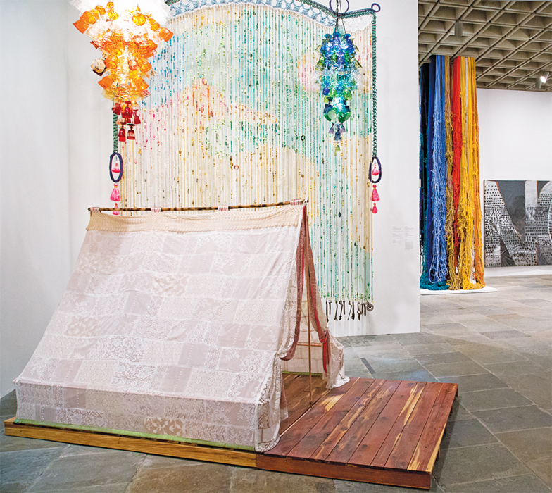 View of the Whitney Biennial, 2014. From left: Joel Otterson, Camp, 2014; Joel Otterson, Curtains Laced with Diamonds Dear for You, 2014; Sheila Hicks, Pillar of Inquiry/Supple Column, 2013–14; Molly Zuckerman-Hartung, Notley, 2013. Hanging, from left: Joel Otterson, 187 Bottoms Up, 2013; Joel Otterson, 84 Bottoms Up, 2013. Photo: Chandra Glick.