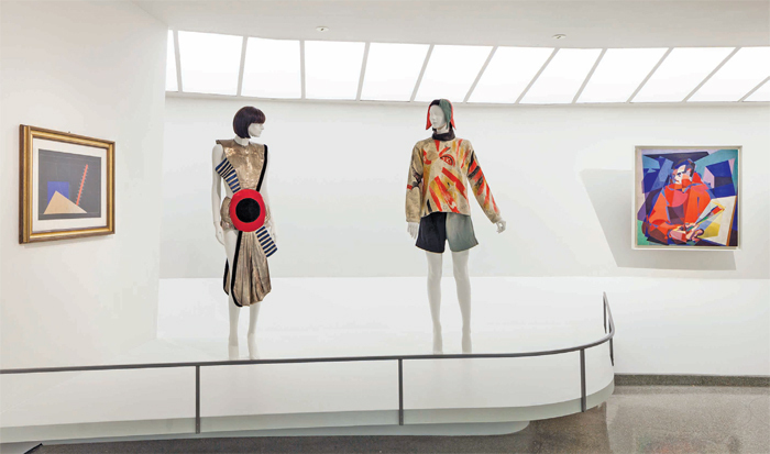 "View of ""Italian Futurism, 1909–1944: Reconstructing the Universe,"" 2014. Four works by Enrico Prampolini. From left: Sketch for Stage Design of The Merchant of Hearts, ca. 1926–27; Costume for Propeller Dance, 1928; Costume for Football Dance, 1928; Simultaneous Self-Portrait, ca. 1923. Photo: Kris McKay."