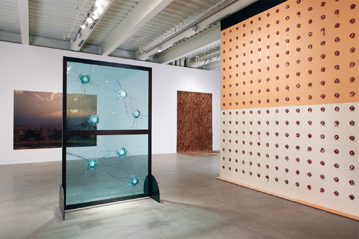"View of ""Ruffneck Constructivists,"" 2014. From left: Tim Portlock, Sunrise—the extended constructivists re-render, 2013; Kendell Geers, Stripped Bare, 2009; Rodney McMillian, Carpet (Office and Ollie's Room), 2012; William Pope.L, Claim, 2002/2014."