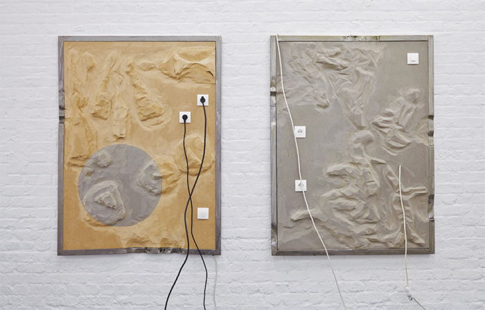 "View of ""Geographies of Contamination,"" 2014. From left: Neil Beloufa, Bowling, 2013; Neil Beloufa, Cats, 2013."