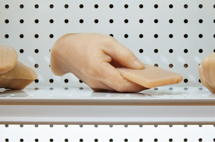 "Josh Kline, Creative Hands (detail), 2013, silicone, commercial shelving, LED lights, 36 1/2 x 26 x 15 1/2"". From ""Speculations on Anonymous Materials,"" 2013–14."