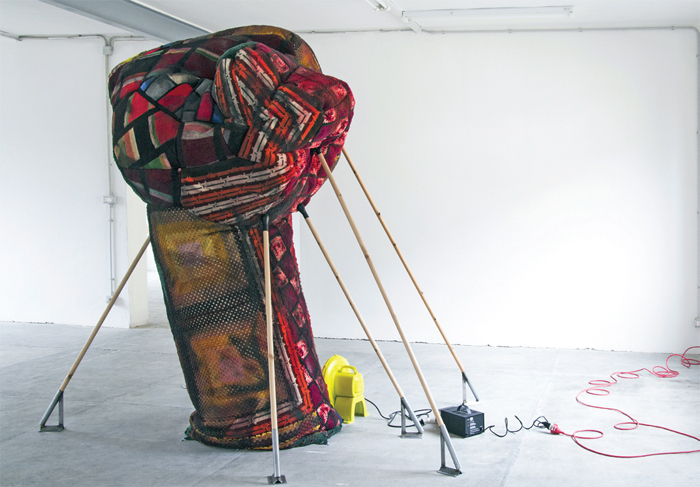 "Andra Ursuta, Soft Power 1, 2013, bedspreads, paint, wood, metal, electric air blower, inflated 94 1/2 x 98 1/2 x 118""."
