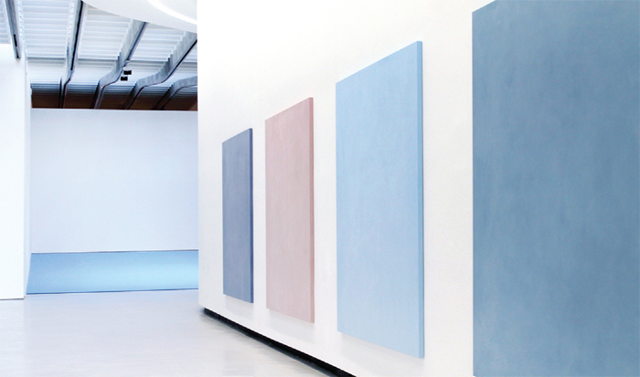 "View of ""Ettore Spalletti,"" 2014. MAXXI National Museum of XXI Century Arts, Rome. Back wall: Voce Bassa (Low Voice), 2014. Right wall: each Parole di colore (Words of Color), 2011."