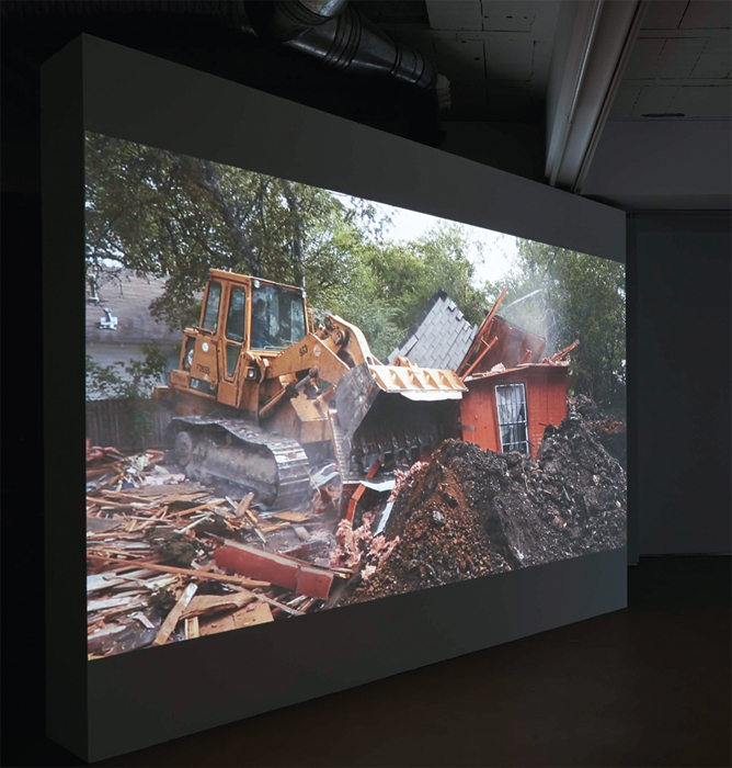 Lara Almarcegui, Buried House, Dallas, 2013, HD video, color, sound, 7 minutes.