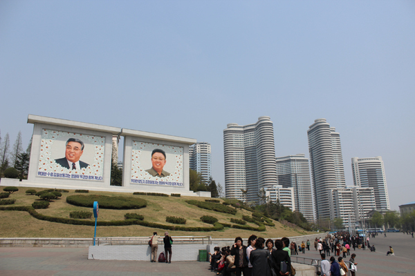 New apartment buildings next to portraits of Kim Il Sung and Kim Jong Il in central Pyongyang. All photos: Travis Jeppesen.