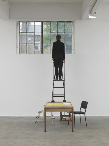 Céline Condorelli, The Double And The Half (to Avery Gordon), 2014, Royal Mail ER office desks, folding steps kitchen stool, security ladder, Heatherley stepladder, yellow polypropylene laminate birch plywood, rubber, dimensions variable.