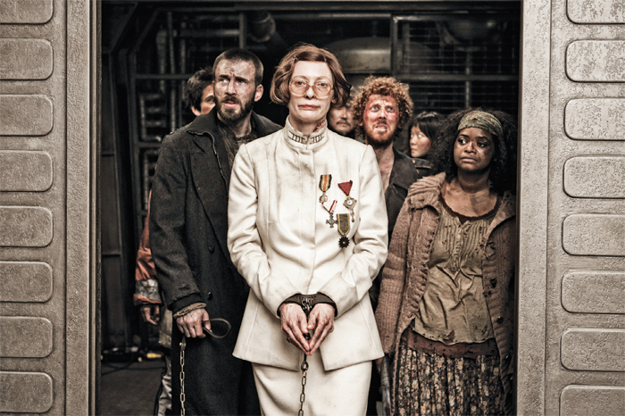 Bong Joon-ho, Snowpiercer, 2013, 35 mm, color and black-and-white, sound, 126 minutes. From left: Curtis (Chris Evans), Mason (Tilda Swinton), Andrew (Ewen Bremner), and Tanya (Octavia Spencer).