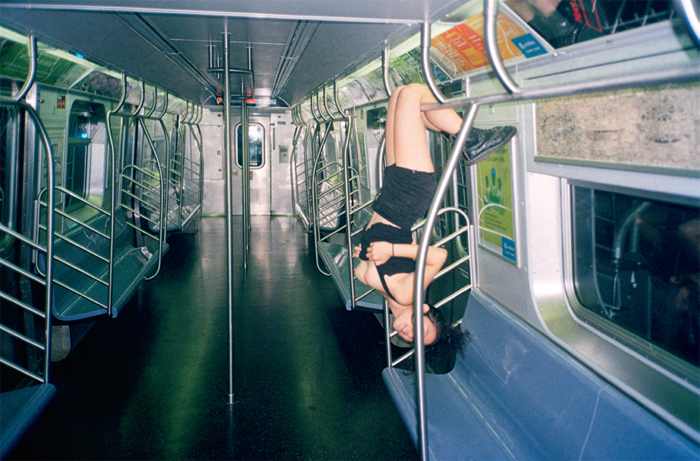 Sandy Kim, Self Portrait on Subway, New York City, 2012, digital C-print.