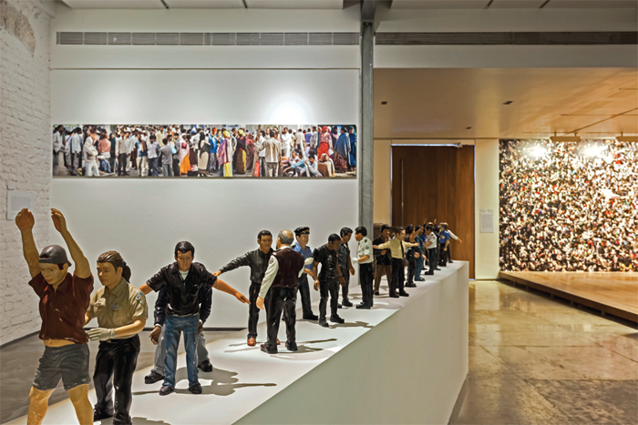 "View of ""Citizen Artist: Forms of Address,"" 2013. Background, from left: Arunkumar H G, Country and City: Everyday Strangers, 2013; Rashid Rana, What Lies Between Flesh and Blood 3, 2009. Foreground: Jitish Kallat, Circadian Rhyme—2 & 3, 2012–13. Photo: Anil Rane."