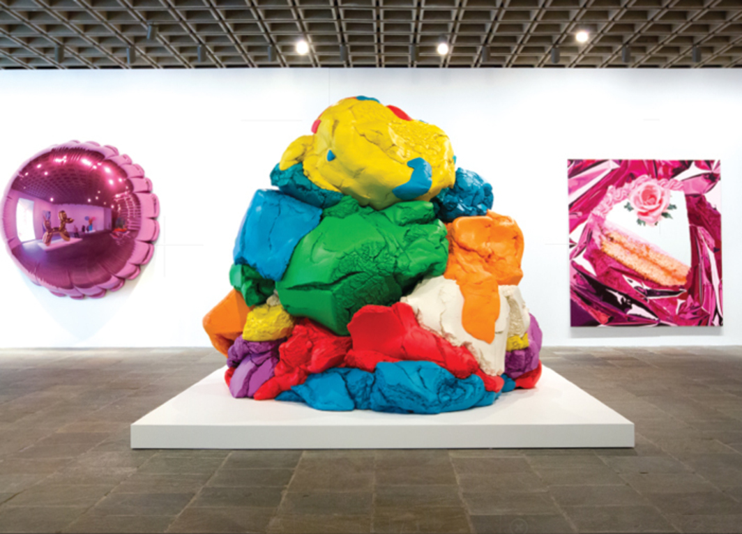 "View of ""Jeff Koons: A Retrospective,"" 2014, Whitney Museum of American Art, New York. From left: Moon (Light Pink), 1995–2000; Play-Doh, 1994–2014; Cake, 1995–97. All from the series ""Celebration,"" 1994–."