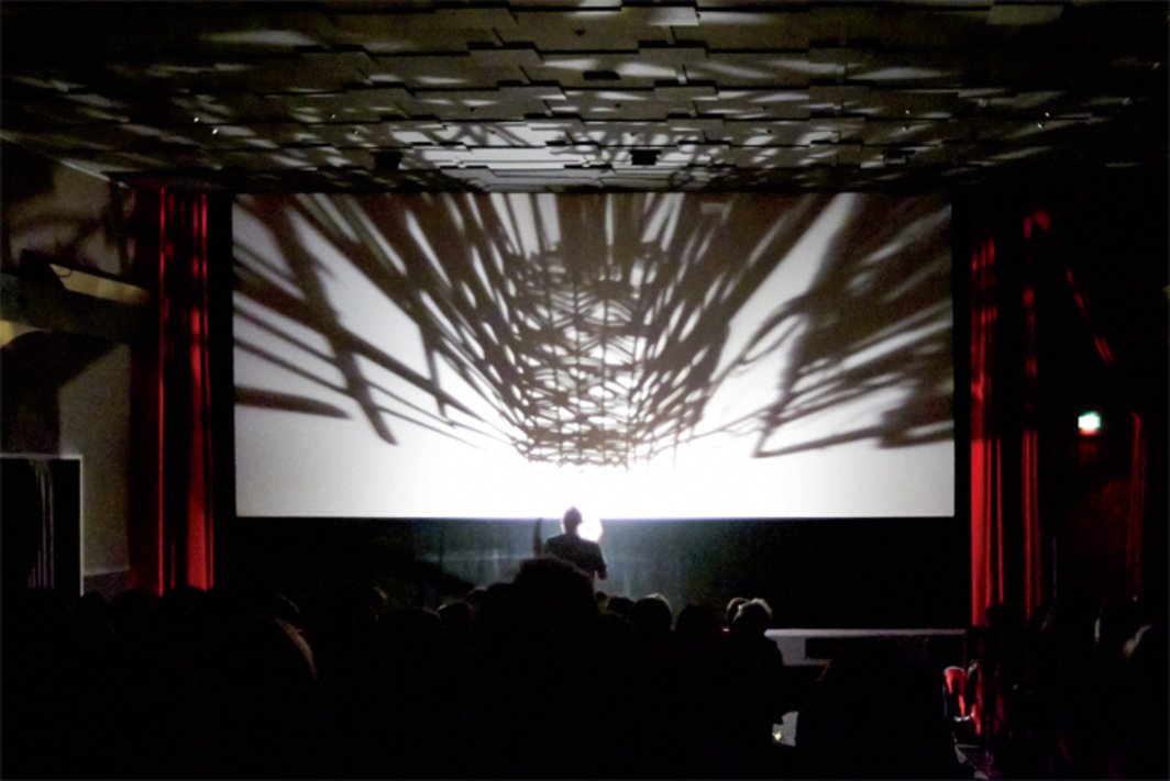 Tony Hill, Point Source, 1973. Performance view, Lichtburg Filmpalast, 60th International Short Film Festival Oberhausen, Germany, May 2, 2014. Tony Hill.