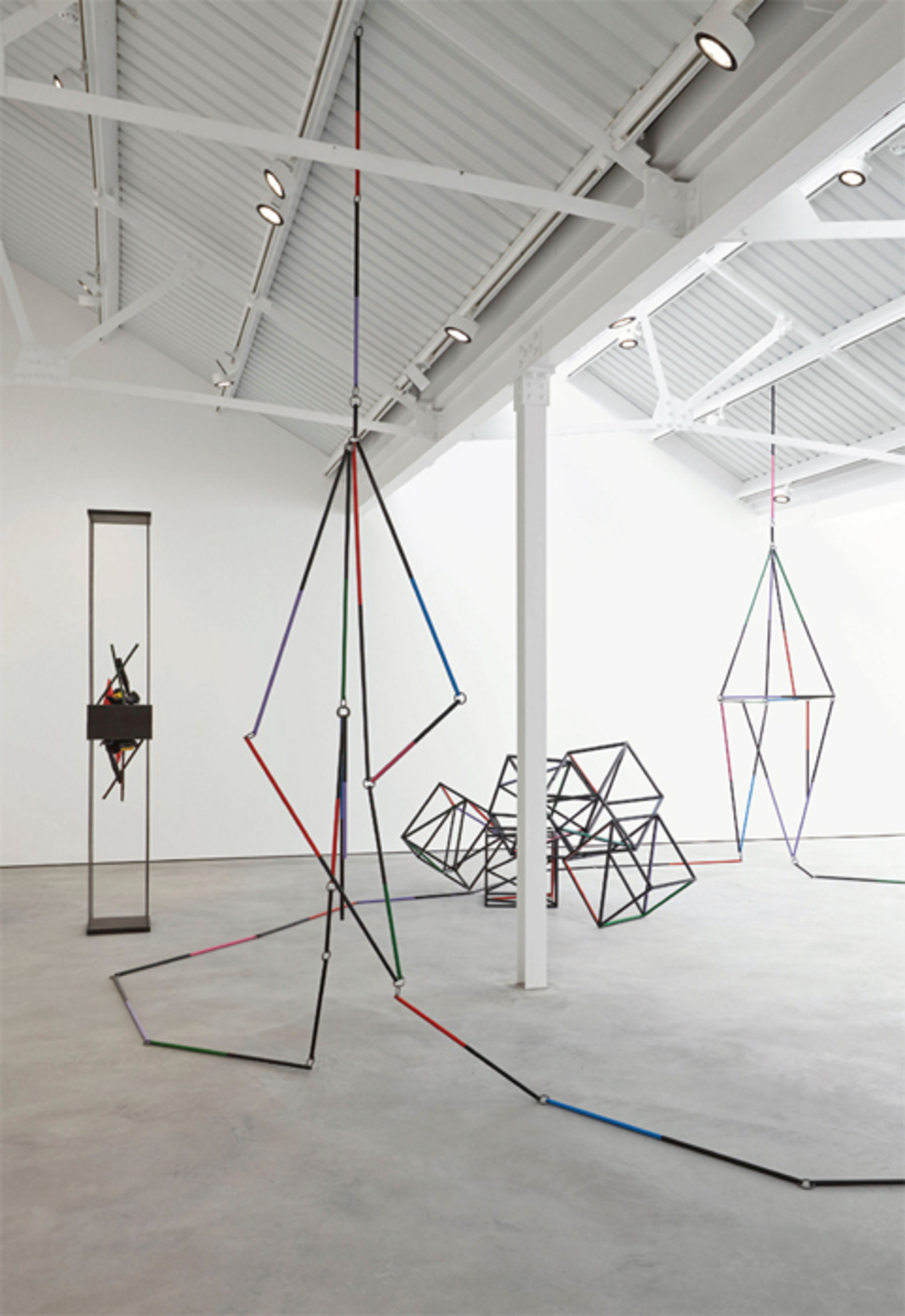 "View of ""Eva Rothschild,"" 2014. Left: Honeymoon, 2014. Foreground and background: Fall, Fall, and Falling, 2014. Middle ground: Lantern, 2014."