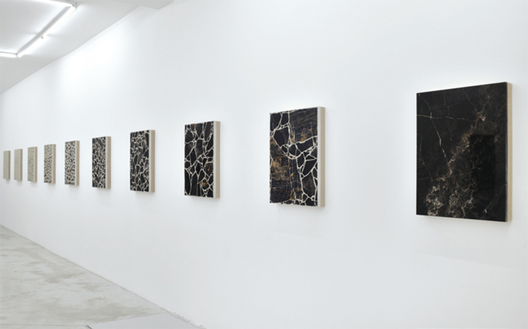 "Analia Saban, Big Bang Series (in Ten Steps), 2014, ten slabs of concrete and marble on canvas, 26 × 20 × 2 1/2"" each. Installation view."