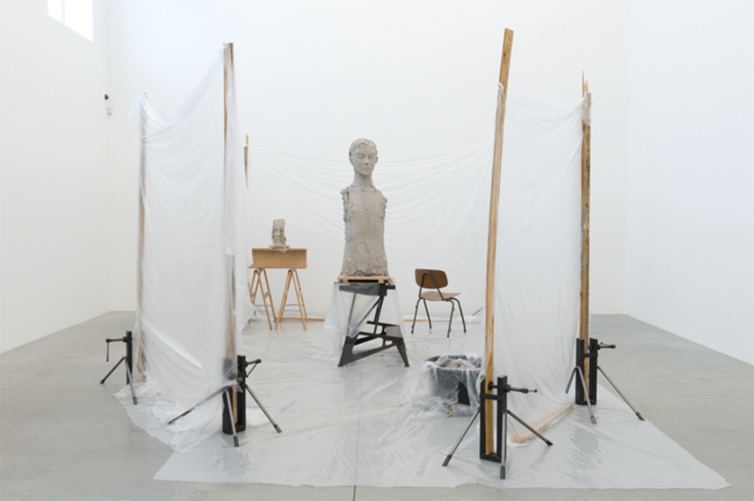 "Mark Manders, Room with Unfired Clay Figure, 2014, painted bronze, wood, iron, plastic, painted ceramic, chair, painted epoxy, 8' 11 1/2"" × 14' 4 1/4"" × 20' 4""."