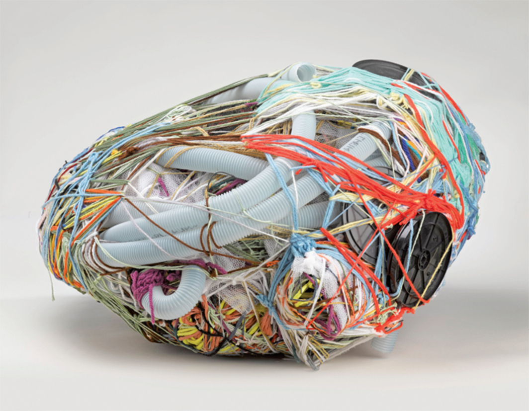 "Judith Scott, Untitled, 2004, fiber and found objects, 28 × 15 × 27""."