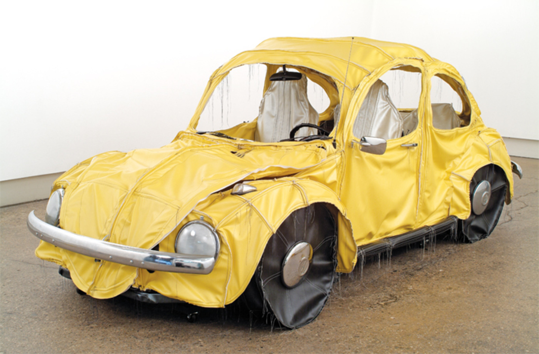 "Margarita Cabrera, Vocho (Yellow), 2004, vinyl, batting, thread, car parts, 5 × 6 × 13'. From ""Pop Departures."""