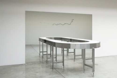 "Agnieszka Kurant, Untitled, 2014, conveyor belt and mirror, mirror: 80 x 120 x 1/4"", conveyor belt: 36 1/2 x 79 x 60 1/2""."