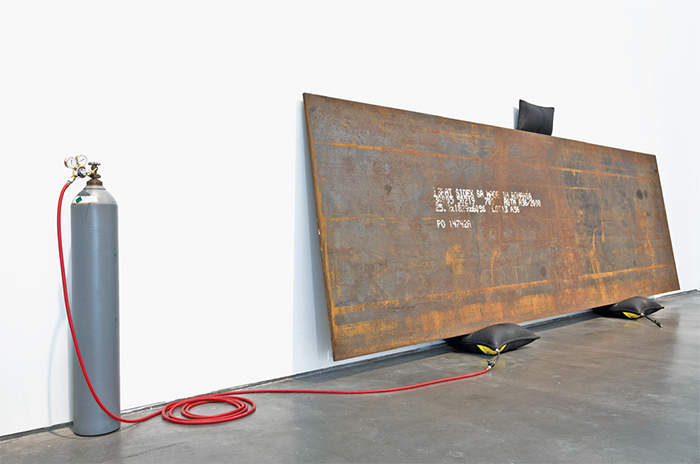 "Simon Starling, Bird in Space, 2004, Romanian steel plate, inflatable jacks, helium tank, hose, 6' × 20' 1/8"" × 11 5/8""."