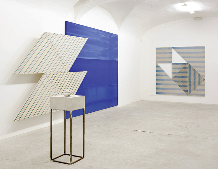 "View of ""Alek O.,"" 2014. Foreground: Banane, 2014. Background, from left: Tangram, 2014; Fino Mornasco, 2014; Tangram, 2014."