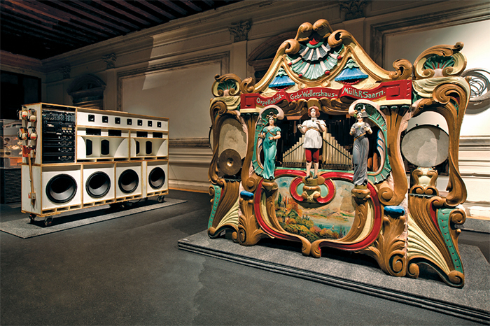 "View of ""Art or Sound,"" 2014. From left: Tom Sachs, Toyan's Jr., 2001; Gebrüder Wellershaus fairground organ, early-twentieth century."
